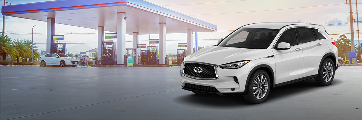 2020 INFINITI QX50 in front of a gas station