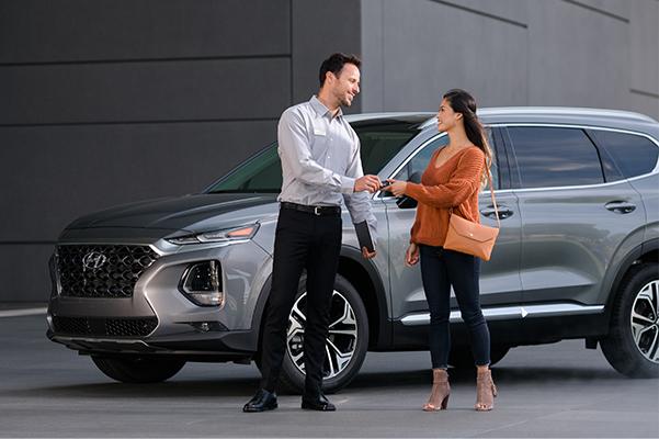 Hyundai maintenance technician talking with customer about service