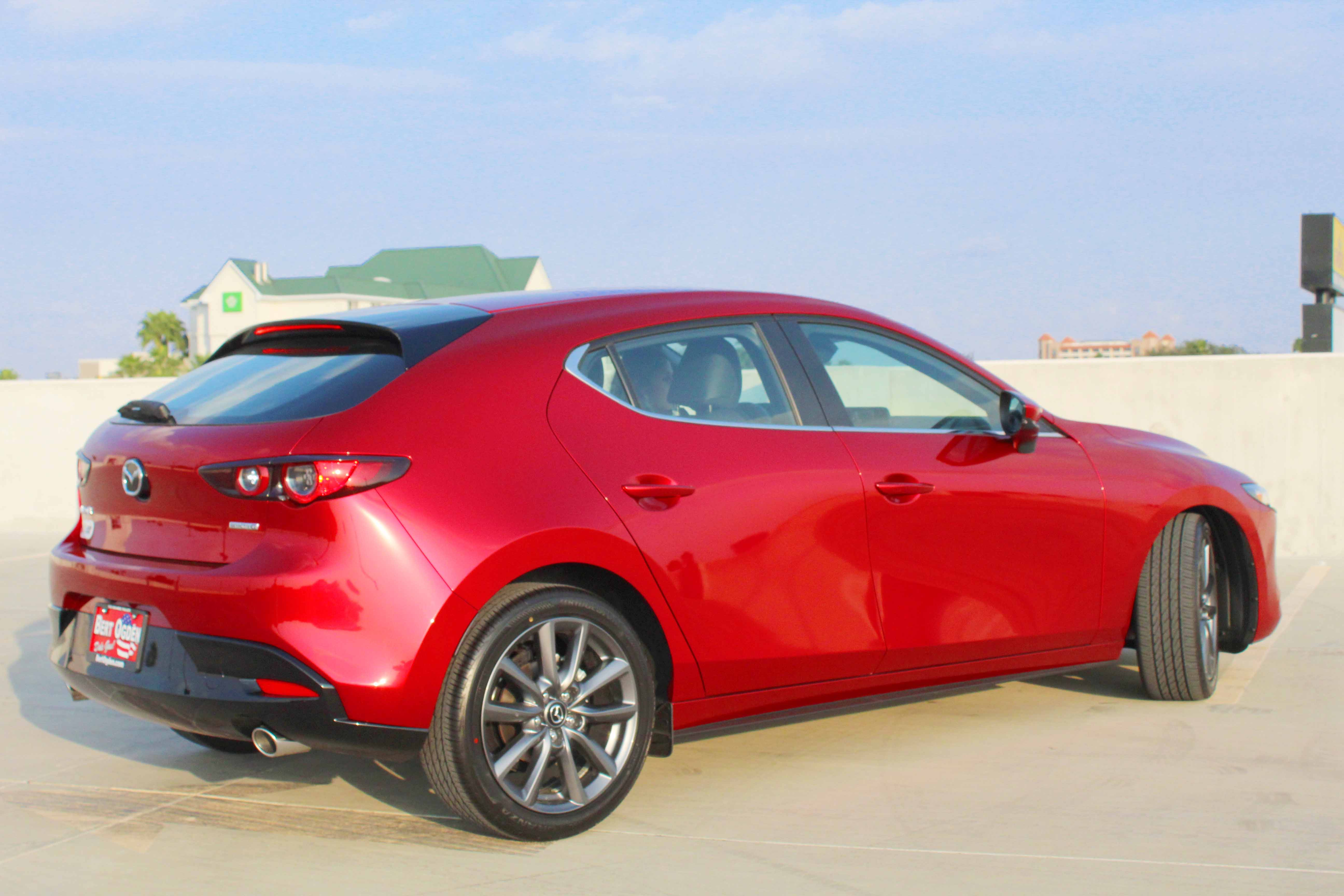rear view of the 2021 mazda3 in red