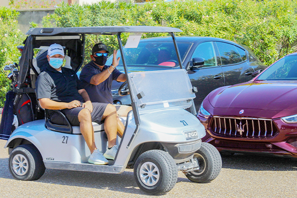 happy customers on a golf cart
