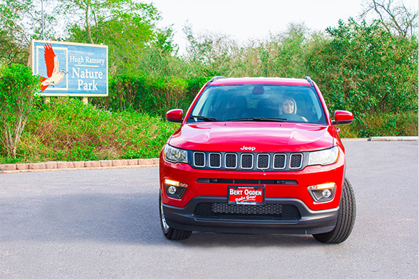 woman sitting in her new 2021 jeep compass