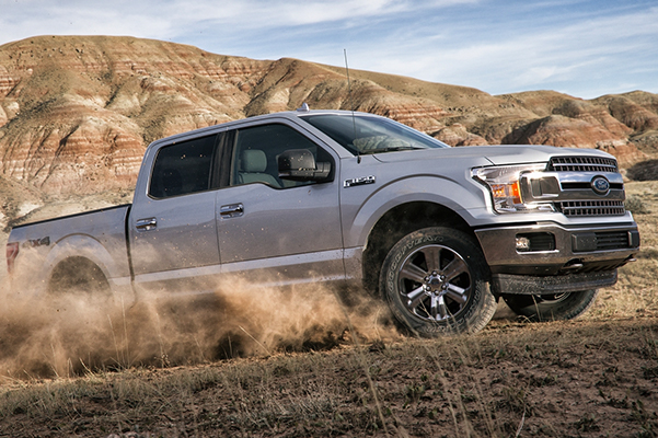 2020 Ford F-150 SuperCrew going uphill on remote dirt road