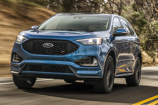 2020 Ford Edge ST Shown in Ford Performance Blue being driven in the woods