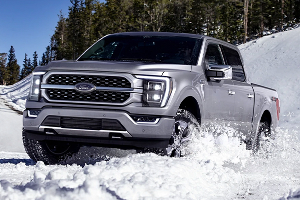 A 2021 Ford F-150 being driven through snow