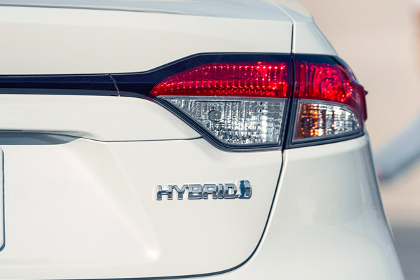 2020 Corolla Hybrid LE shown in Blizzard Pearl