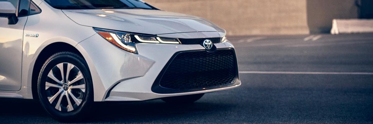 2021 Toyota Corolla Hybrid LE shown in Blizzard Pearl