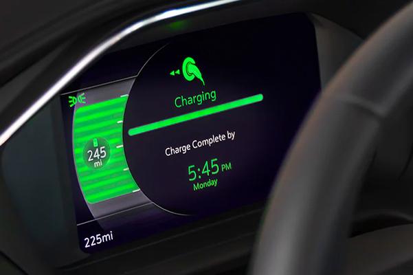 Steering wheel dash displaying charging information