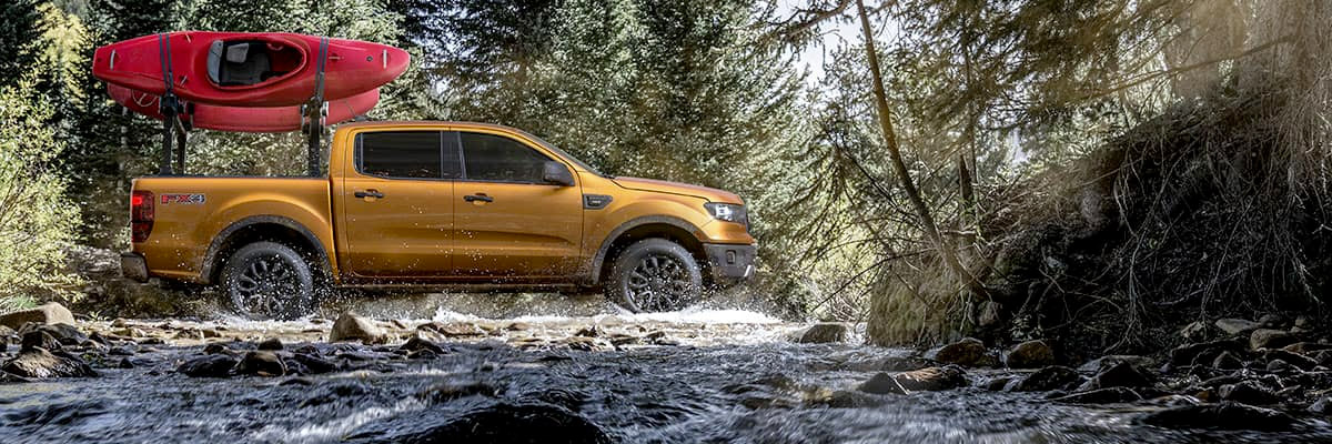 2019 Ford Ranger in the woods with kayaks