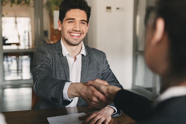 new team member accepting a job with a handshake