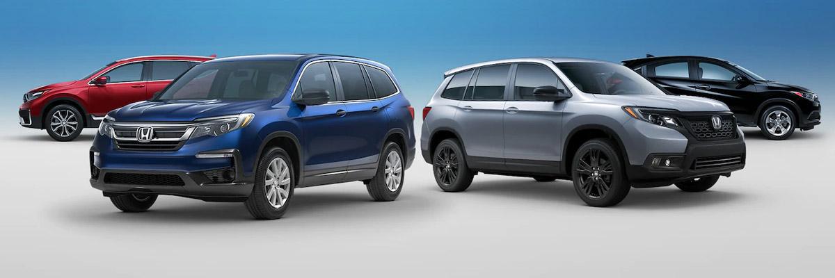 honda suv line up parked on a blue studio background