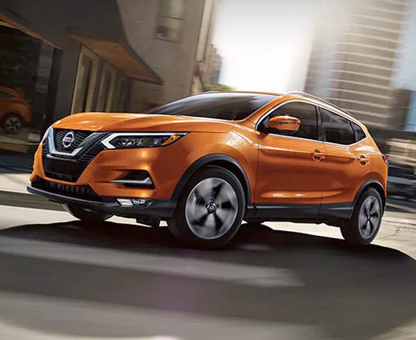 Nissan Rogue Sport driving on the road