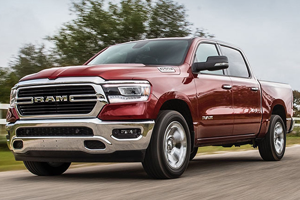 Exterior side view of a red 2020 Ram 1500