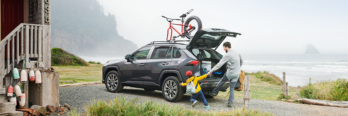 2022 Toyota Rav4 with father and child walking behind it