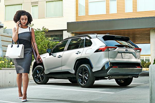 Lady walking infront of 2022 Toyota Rav4